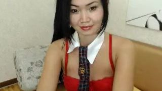 Hot Asian brunette wearing a necktie poses for the webcam i